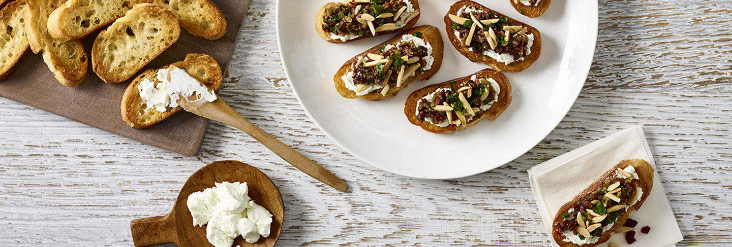 Warm Chevre Crostini with Basil Tapenade
